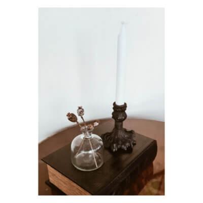 ljusstake gjutjarn lag svart kronljus stilleben